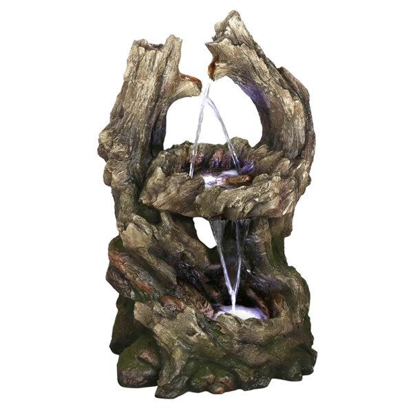 Fontána imitující dřevěné kmeny stromů, kterými protéká voda