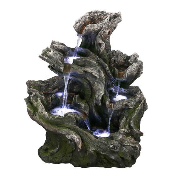 Dřevěná umělá fontána imitující kmeny stromu